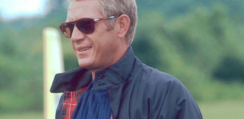steve mcqueen wearing persol sunglasses and harrington jacket