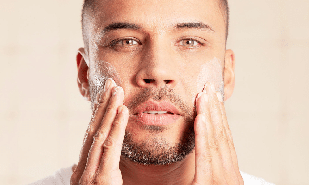 mens applying skincare products