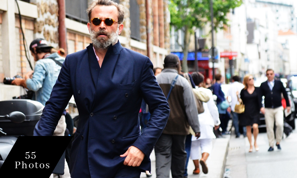 man walking with blue suit