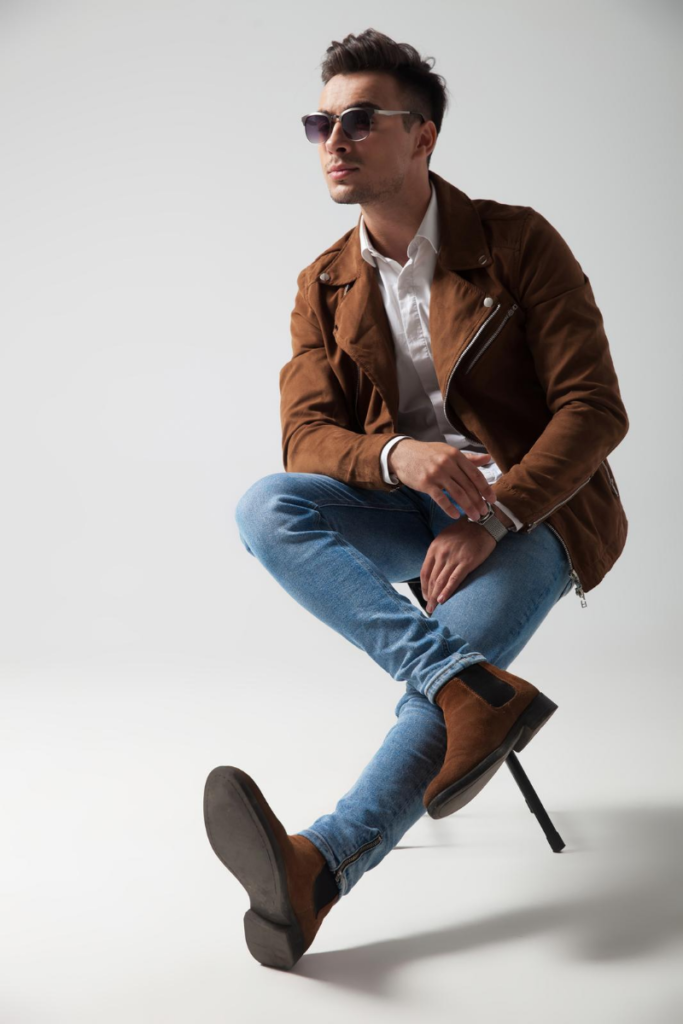 model wearing blue jeans and suede chelsea boots