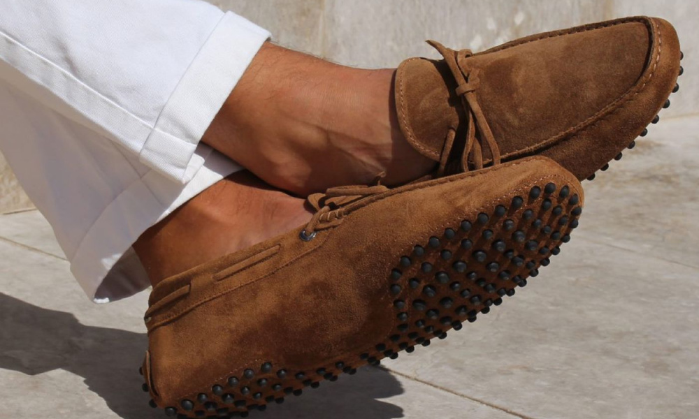 man wearing summer driving shoes
