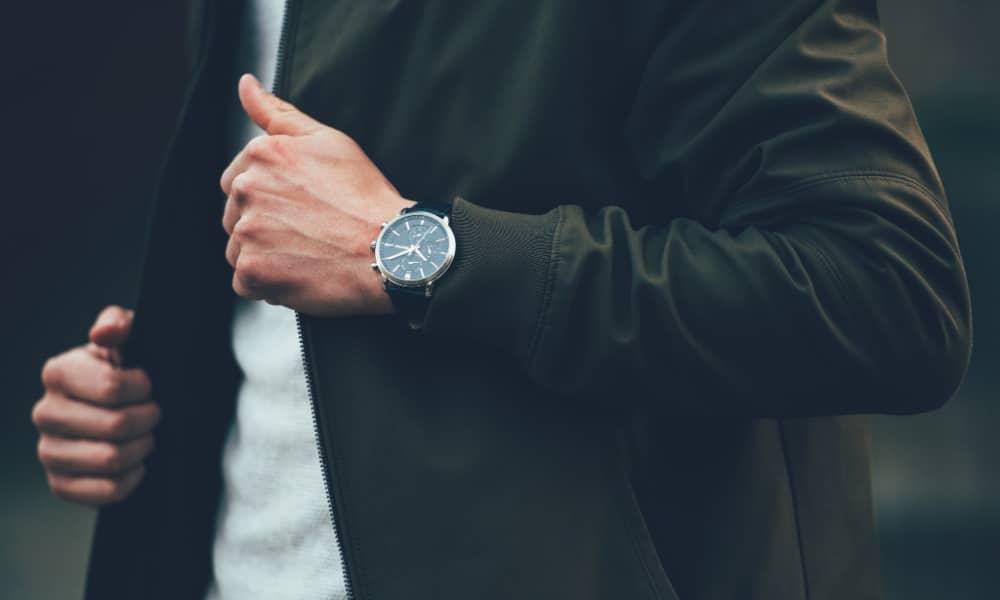 man wearing minimalist watch with coat