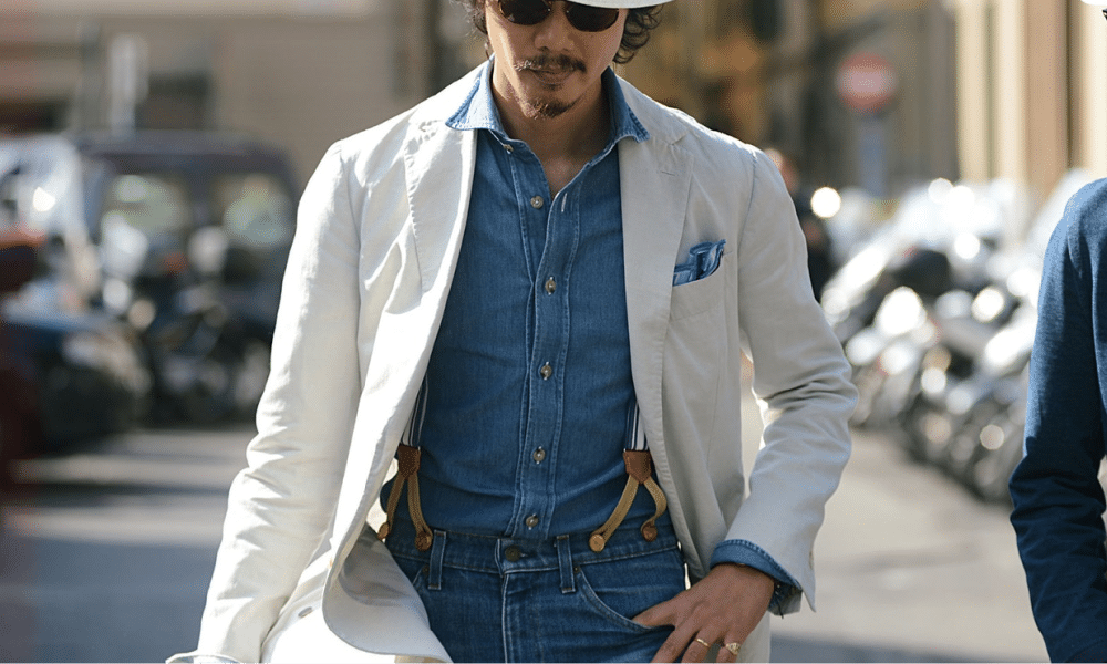 street style look of man wearing blazer and jeans