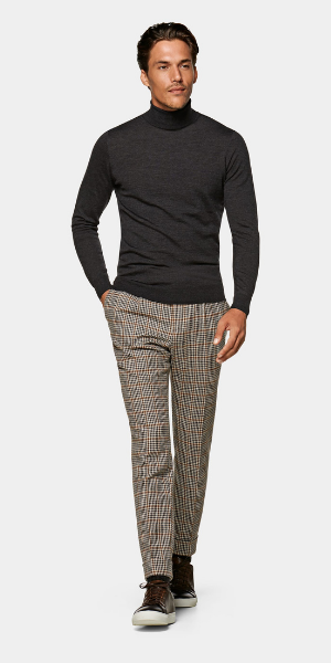 model in grey roll neck and check trousers