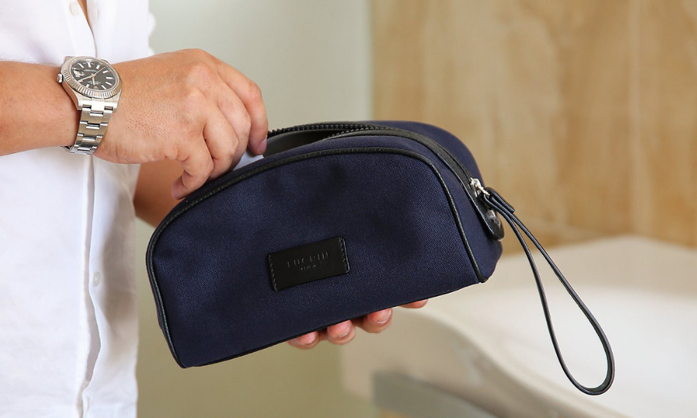 man with small toiletries bag